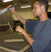 Industries employee gets ready to make signs in BVRS' new building at 1816 Locust St., Pittsburgh, PA 15219.